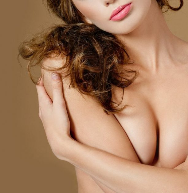 What is breast lift surgery with implants?